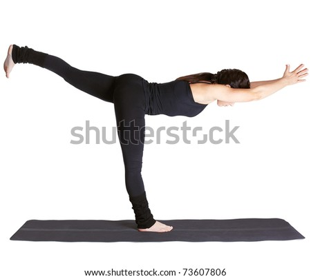 full-length portrait of beautiful woman working out yoga excercise Virabhadrasana III on fitness mat - stock photo