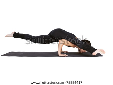 full-length portrait of beautiful woman working out yoga excercises kaundiniasana pose on fitness mat - stock photo