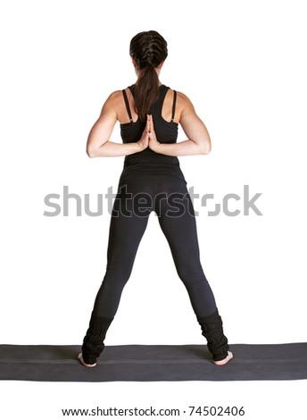 full-length portrait of beautiful woman working out yoga excercises namaste for parshvottanasana on fitness mat - stock photo