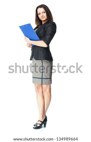Full length portrait of beautiful young smiling businesswoman holding clipboard isolated on white background - stock photo
