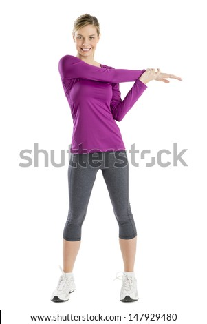 Full length portrait of beautiful young woman doing stretching exercise isolated over white background - stock photo