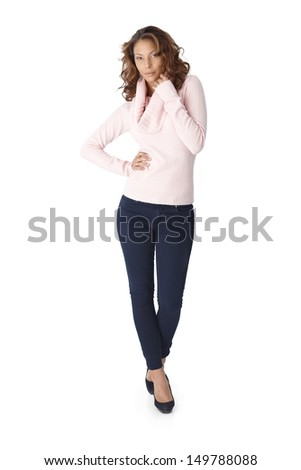 Full length portrait of beautiful young woman over white background.
