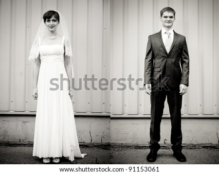 Full Length portrait of bride and groom standing against wall