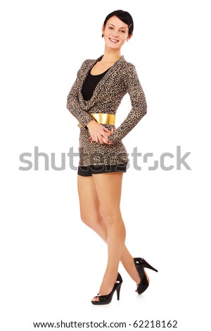 full-length portrait of brunette girl in leopard dress on white