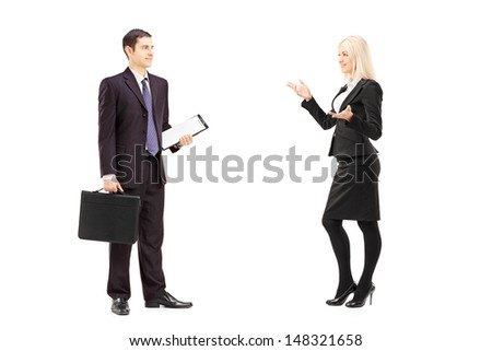 Full length portrait of business colleagues having a conversation isolated on white background - stock photo
