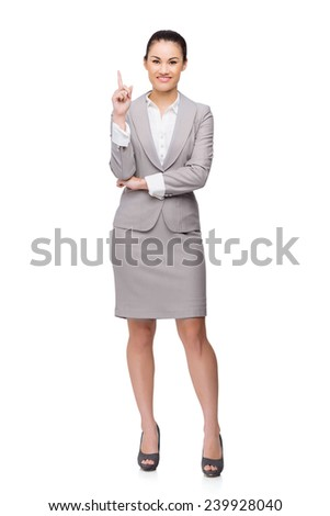 Full-length portrait of business lady having an idea - stock photo