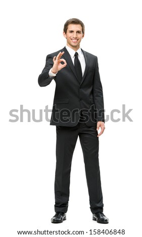 Full-length portrait of business man ok gesturing, isolated on white. Concept of leadership and success - stock photo
