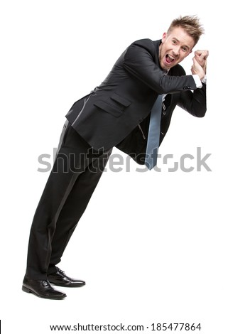 Full-length portrait of business man shoving something who wears suit with blue tie, isolated on white - stock photo