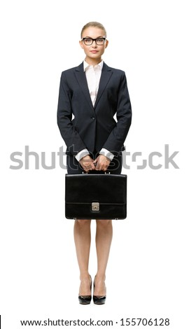 Full-length portrait of business woman handing case, isolated on white. Concept of leadership and success - stock photo