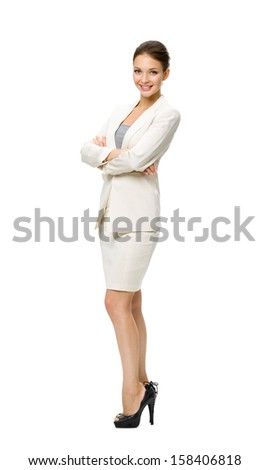 Full-length portrait of business woman with her hands crossed, isolated. Concept of leadership and success - stock photo