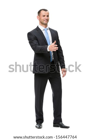 Full-length portrait of businessman handshaking, isolated on white. Concept of leadership and success - stock photo