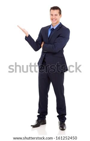 full length portrait of businessman presenting - stock photo