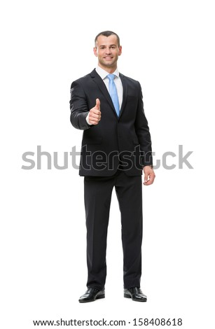 Full-length portrait of businessman who thumbs up, isolated. Concept of leadership and success - stock photo