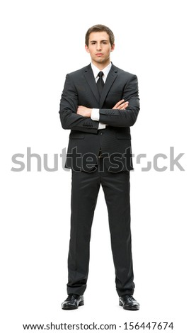 Full-length portrait of businessman with hands crossed, isolated on white. Concept of leadership and success - stock photo