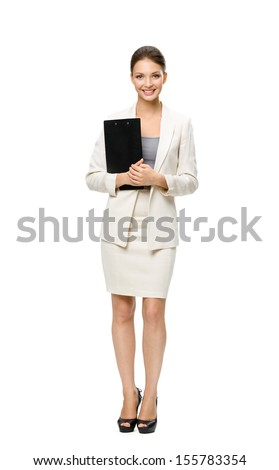 Full-length portrait of businesswoman keeping folder, isolated on white. Concept of leadership and success