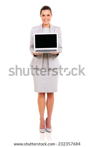 full length portrait of businesswoman presenting laptop - stock photo
