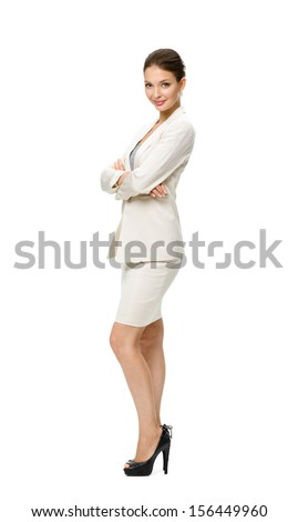 Full-length portrait of businesswoman with her hands crossed, isolated. Concept of leadership and success - stock photo