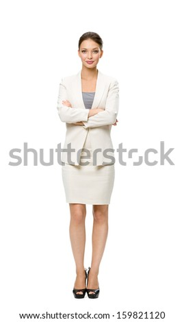 Full-length portrait of businesswoman with her hands crossed, isolated on white background. Concept of leadership and success - stock photo