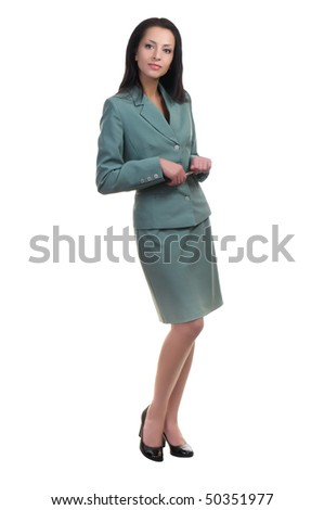 Full-length portrait of businesswoman with pen in hands