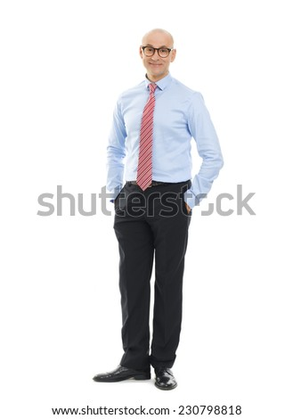Full length portrait of casual businessman standing against white background.  - stock photo