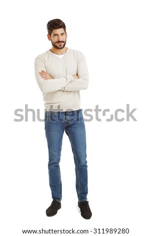 Full length portrait of casual businessman with arms crossed standing against white background while looking at camera and smiling. - stock photo