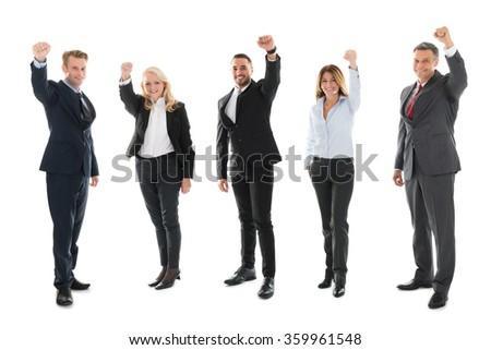 Full length portrait of cheerful business people celebrating success against white background - stock photo