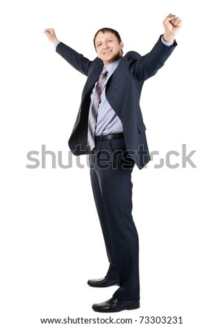 Full length portrait of cheerful businessman with hands raised in victory, over white background - stock photo