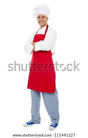 Full length portrait of chef posing in style isolated over white background