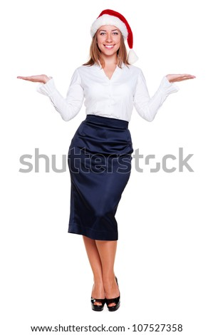 full length portrait of christmas businesswoman holding empty copyspace on her open palms. studio shot over white background - stock photo