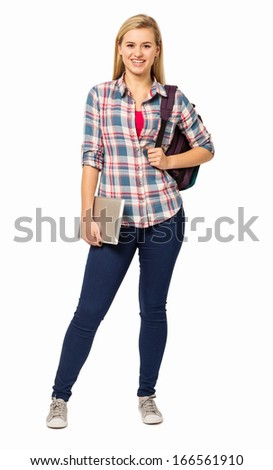 Full length portrait of college student with backpack and digital tablet against white background. Vertical shot. - stock photo