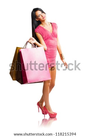 Full length portrait of colorful fashionable shopping girl. - stock photo
