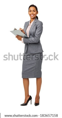 Full length portrait of confident businesswoman holding clipboard against white background. Vertical shot. - stock photo