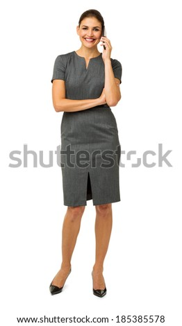 Full length portrait of confident businesswoman using smart phone against white background. Vertical shot. - stock photo
