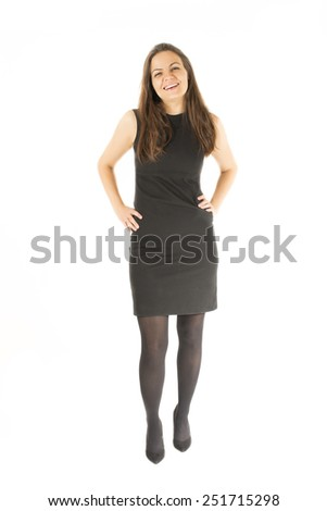 Full length portrait of confident businesswoman with hands on hips standing over white background. Vertical shot - stock photo