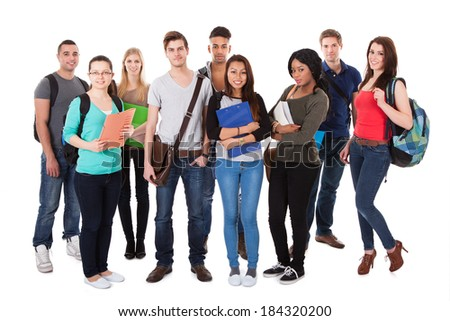 Full length portrait of confident college students standing together against white background