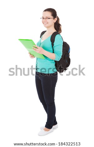 Full length portrait of confident female student standing against white background