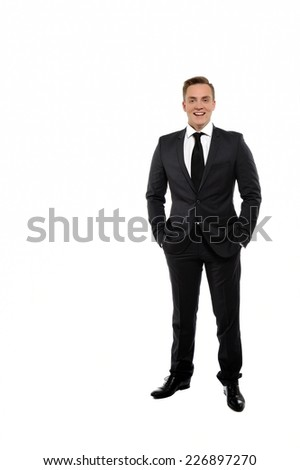 Full length portrait of confident young businessman in formals  smiling and standing isolated on white background. - stock photo