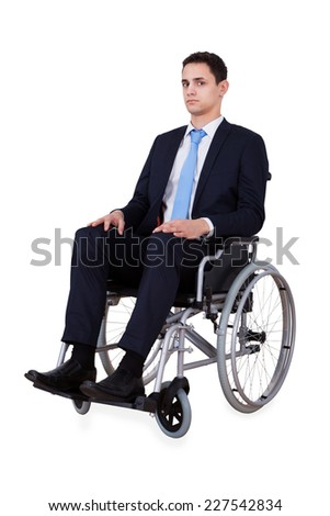 Full length portrait of confident young businessman sitting in wheelchair isolated over white background - stock photo