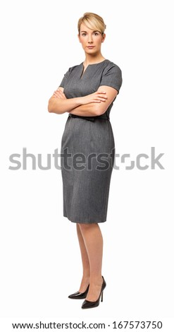Full length portrait of confident young businesswoman with arms crossed over white background. Vertical shot. - stock photo