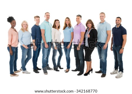 Full length portrait of creative business people standing together against white background