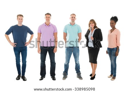 Full length portrait of creative business people standing with manager against white background - stock photo