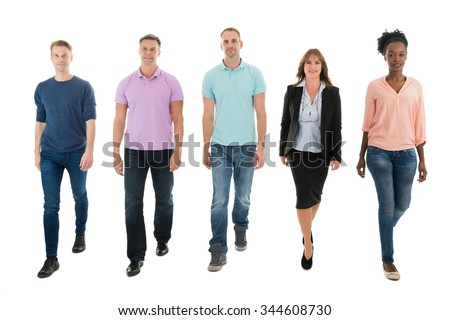 Full length portrait of creative business people walking with manager against white background - stock photo