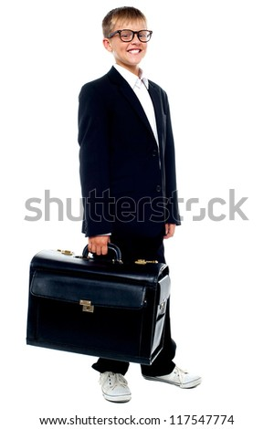 Full length portrait of cute boy carrying a briefcase isolated on white background - stock photo
