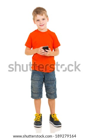 full length portrait of cute boy holding smart phone - stock photo