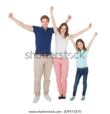 Full length portrait of excited family against white background - stock photo