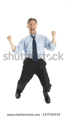 Full length portrait of excited mature businessman celebrating success against white background