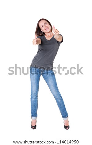 full length portrait of excited young woman showing thumbs up over white background - stock photo