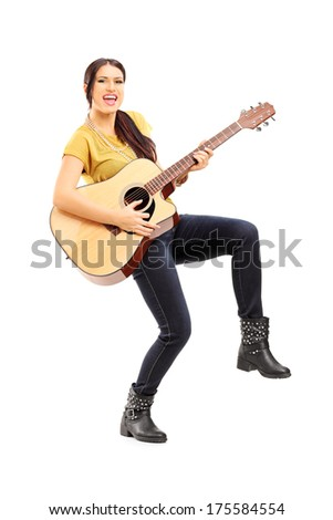 Full length portrait of female musician playing on acoustic guitar isolated on white background