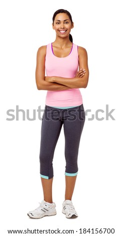 Full length portrait of fit young woman standing arms crossed over white background. Vertical shot. - stock photo