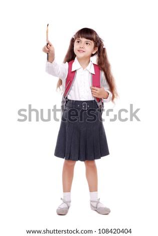 Full length portrait of girl holding the painting brush - stock photo